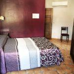 habitación cuádruple dormitorio hostal alcaidia